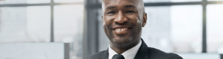 Man in business suit standing and smiling