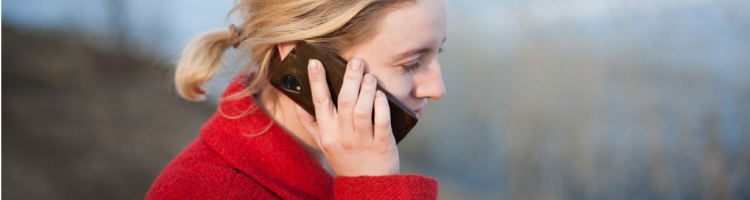 Woman holds cell phone to her ear